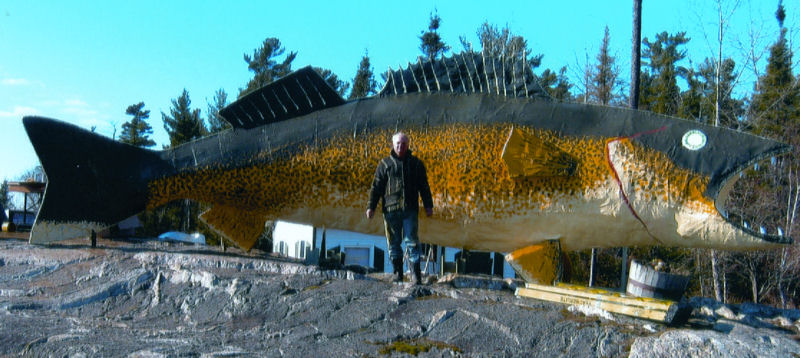Mike Camp in front of the new Marten River fish landmark he has just completed