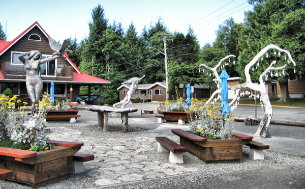 Mike Camp's sculpture garden featuring Raven Lady 1992, Wanderer's Tree 2015, Surfer Girl 2016 located in Ucluelet, Vancouver Island, BC